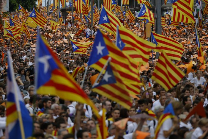 People wave pro-independence Catalan flags, known as the Estelada flag, during a rally calling for the independence of Catalonia, in Barcelona, Spain, Friday, Sept. 11, 2015. Advocates of independence for Spain's northeastern region of Catalonia on Friday launched their campaign to try to elect a majority of secessionists in regional parliamentary elections on Sept. 27. (AP Photo/Francisco Seco)